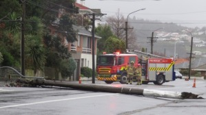 Power Pole crashes in wind. Photo credit to Hamish McNeilly: Fairfax NZ LtdSTUFF